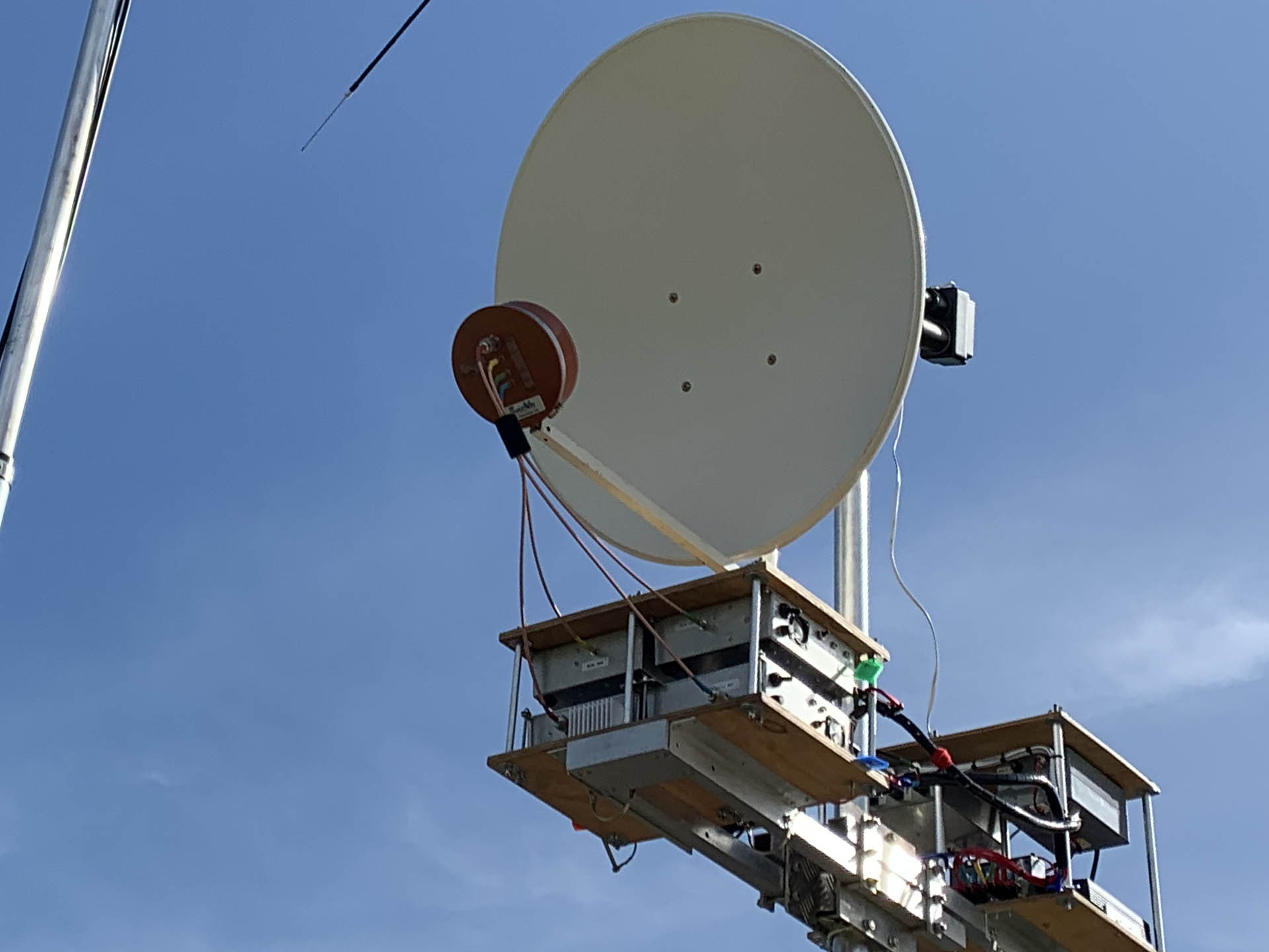 Picture of Peter VK3APW's RF Hamdesign feed in front of an offset dish. 10 GHz Amateur Radio